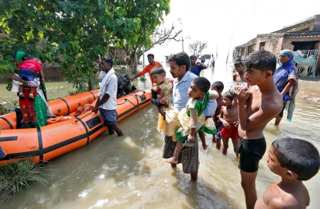 People are rescued from a flooded village in Motihari