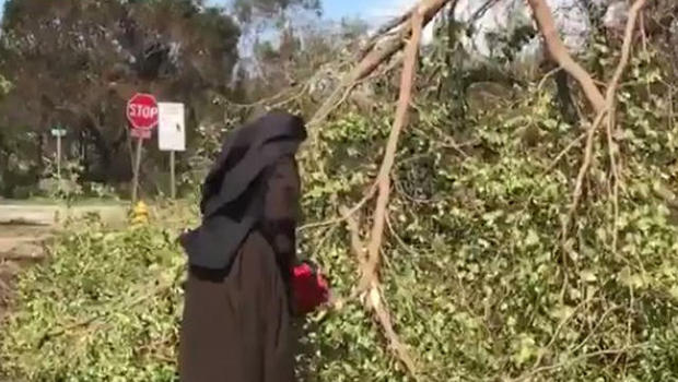nun-grabs-chain-saw-to-clear-trees-in-miami-post-irma-0917
